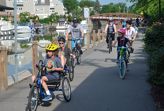 Hand cyclists riding along the Erie Canal in Fairport