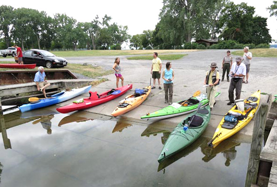 A group of paddlers at a launch site